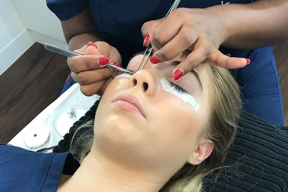 Lash Artist applying eyelash extensions