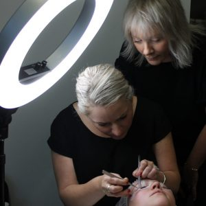 Eyelash Extensions Application being taught to student