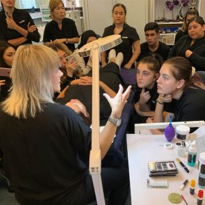 Eyelash Trainer Giving Tips of the Trade to Beauty Students