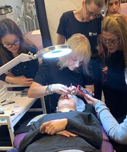 Lash Trainer Showing Students how to apply false eyelashes